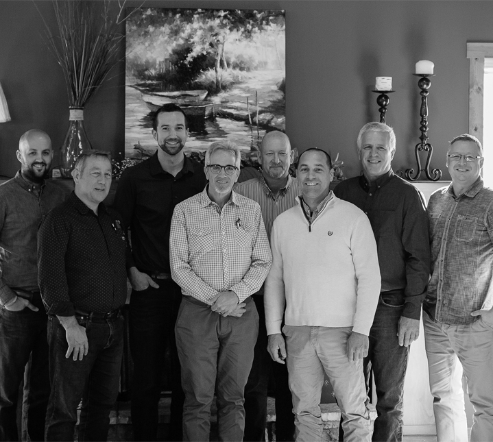 Black and white group photo of the Board of Directors of Door of Hope